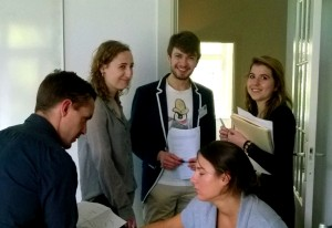MEELS students discussing strategy in a simulation game provided by planpolitik